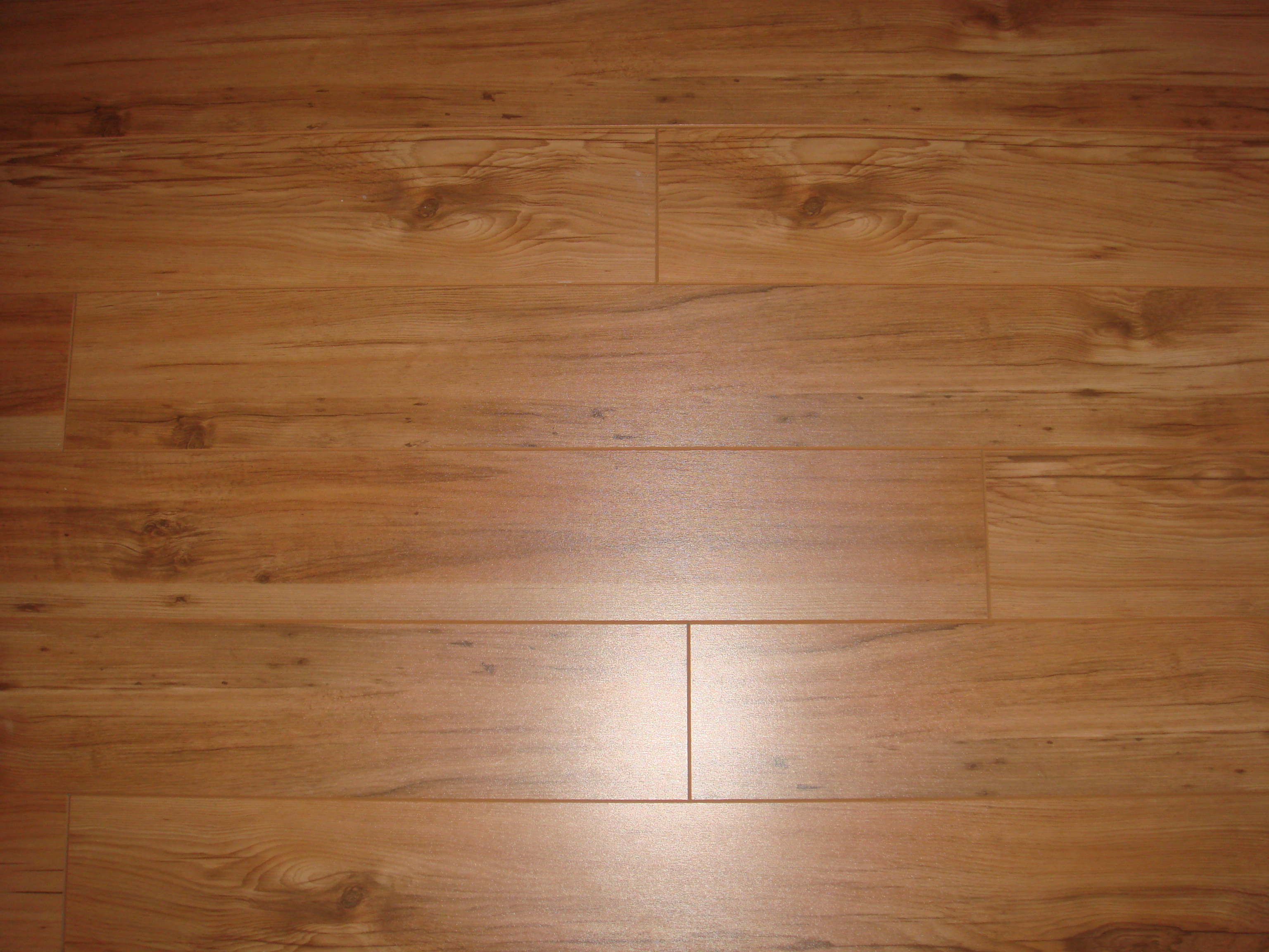 The pros and cons of laminate wood flooring wood floors plus for Laminated wood